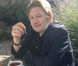 Shane MacGowan has breakfast in his Dublin garden. Image by Victoria Mary Clarke