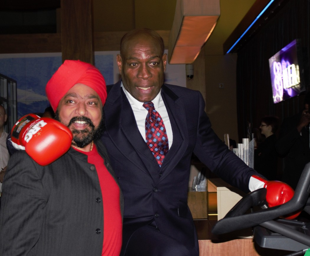 Frank Bruno poses with boxing gloves and chef Tony Singh