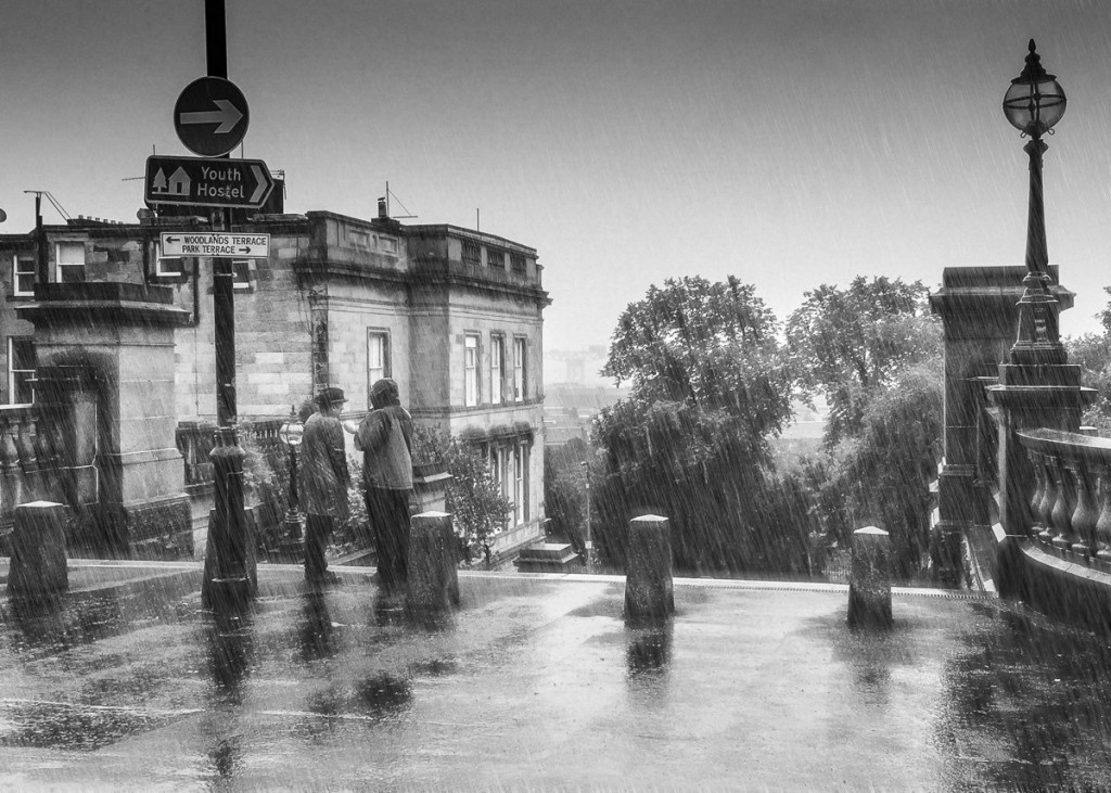 PJ Moore and Ken Sweeney, in the rain. Photo: © www.johngmoore.com