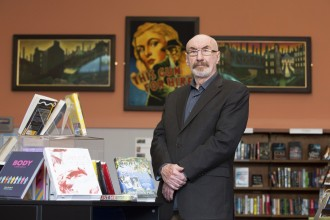 Andrew Hay (centre) unveils his paintings at Dennistoun Library.