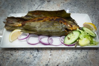 MEEN POLLICHATHU  A Keralian delicacy of seabream using fresh spices, herbs, coconut, lemon and wrapped up in banana leaf and roasted.