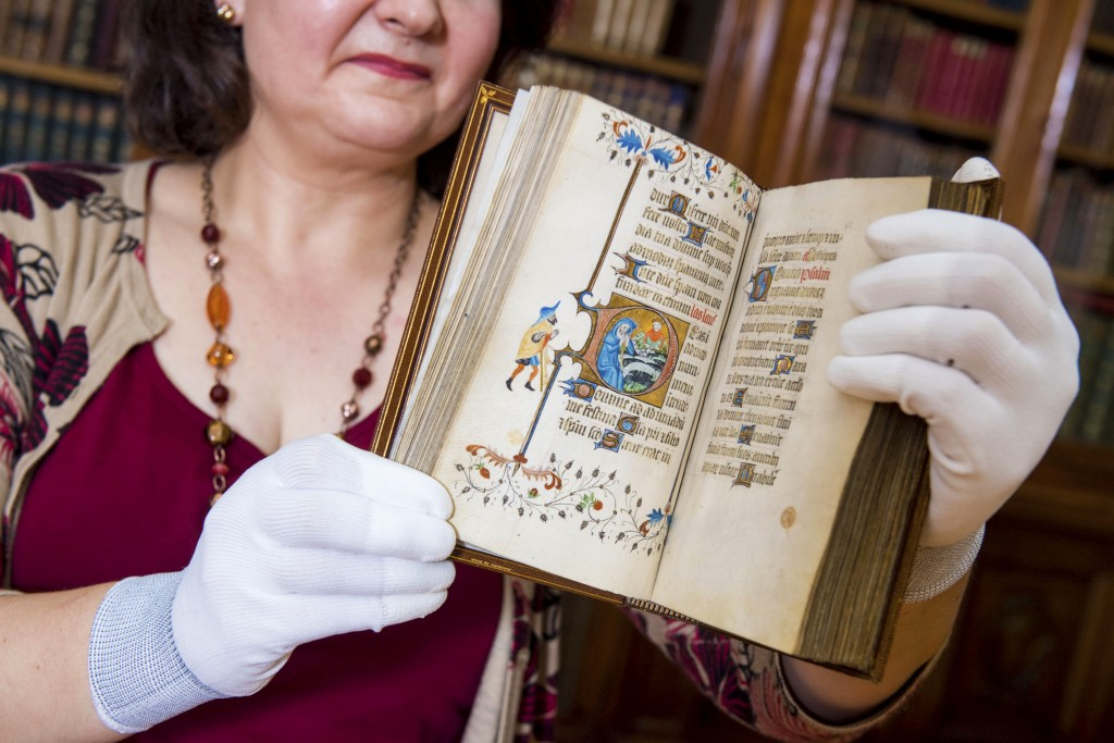 Pictured: Mitchell Librarian Susan Taylor with the 15th century French Book of Hours.