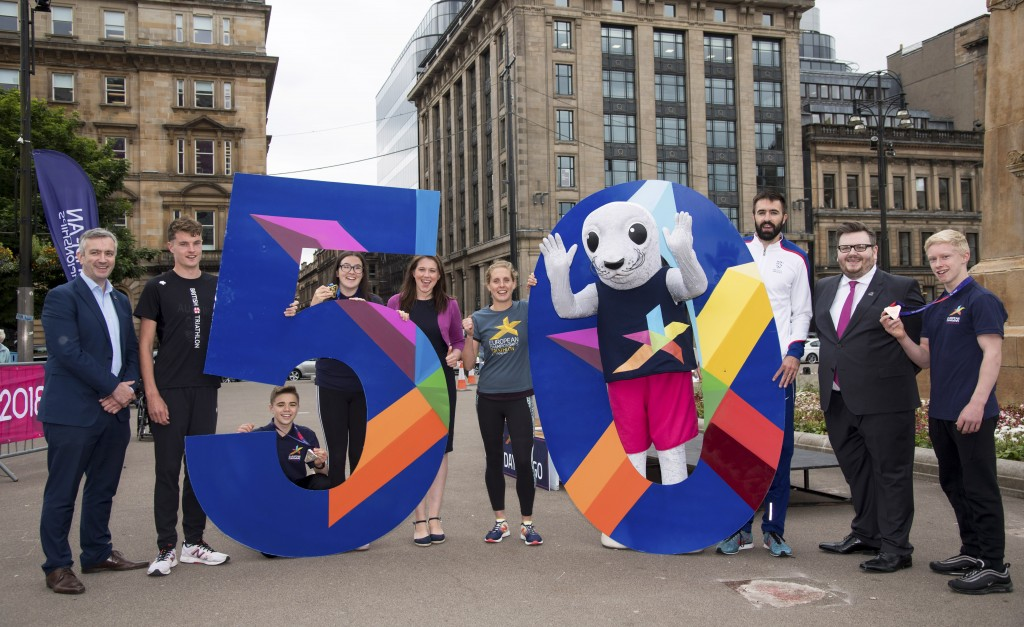 (L-R) Colin Hartley the Championship Director for Glasgow 2018, Marc Austin, Danny Abbott, Mia Patton, Sports Minister Aileen Campbell, Jess Learmonth, Bonnie the Seal, Martyn Rooney, Depute Leader of Glasgow City Council David McDonald and Fraser Lynes.