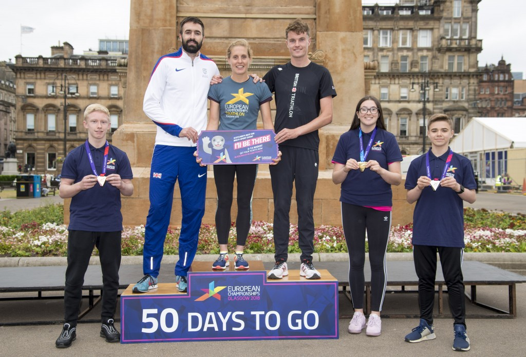 (L-R) Fraser Lynes, Martyn Rooney,y, Jess Learmonth and Marc Austin, Mia Paton, and Danny Abbott holding the Championship medals.