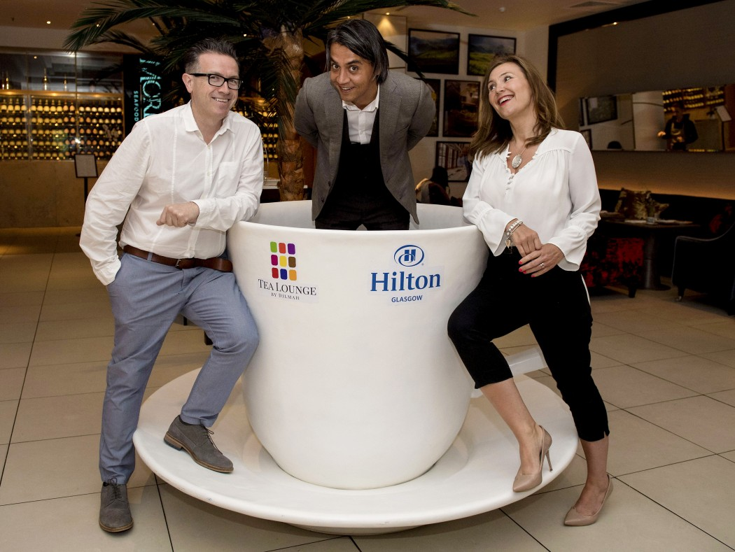 Hilton Glasgow officially opens the UK's first Tea Lounge by Dilmah in partnership with internationally renowned ethical tea brand Dilmah.   Pictured is Award-winning tea sommelier and mixologist Robert Schinkel (centre) with Still Game actors Mark Cox and Jane McCarry.