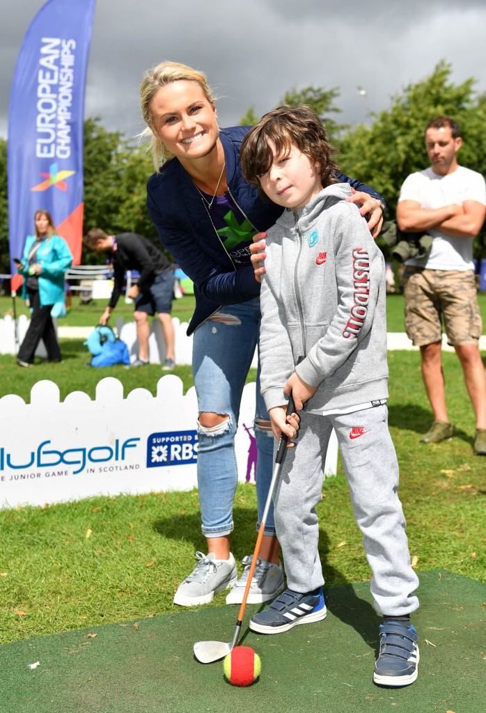 Glasgow 2018 ambassador Carly Booth is pictured at Go Live! at the Green as she helps Daniel Cunningham with some golf lessons