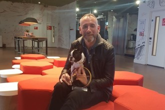 Michael Weston, Curator at Radisson RED Glasgow and the hotel dog Baxter with their award